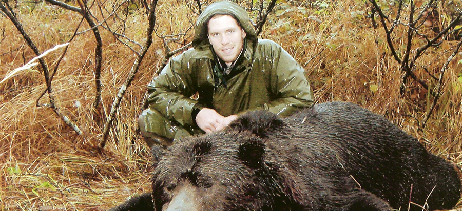 Guide-Zach-Richardson-with-his-after-season-10-foot-Brown-Bear-2005